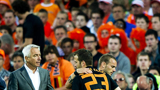 Wesley Sneijder (R) Leaves The Field And Salutes Teammate Rafael Van Der Vaart (R) As Coach Bert Van Marwijk (L) Looks  AFP/Getty Images
