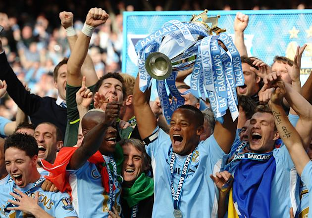Manchester City's Belgian Captain Vincent Kompany Lifts The Premier League Trophy   RESTRICTED TO EDITORIAL USE. No Use AFP/Getty Images