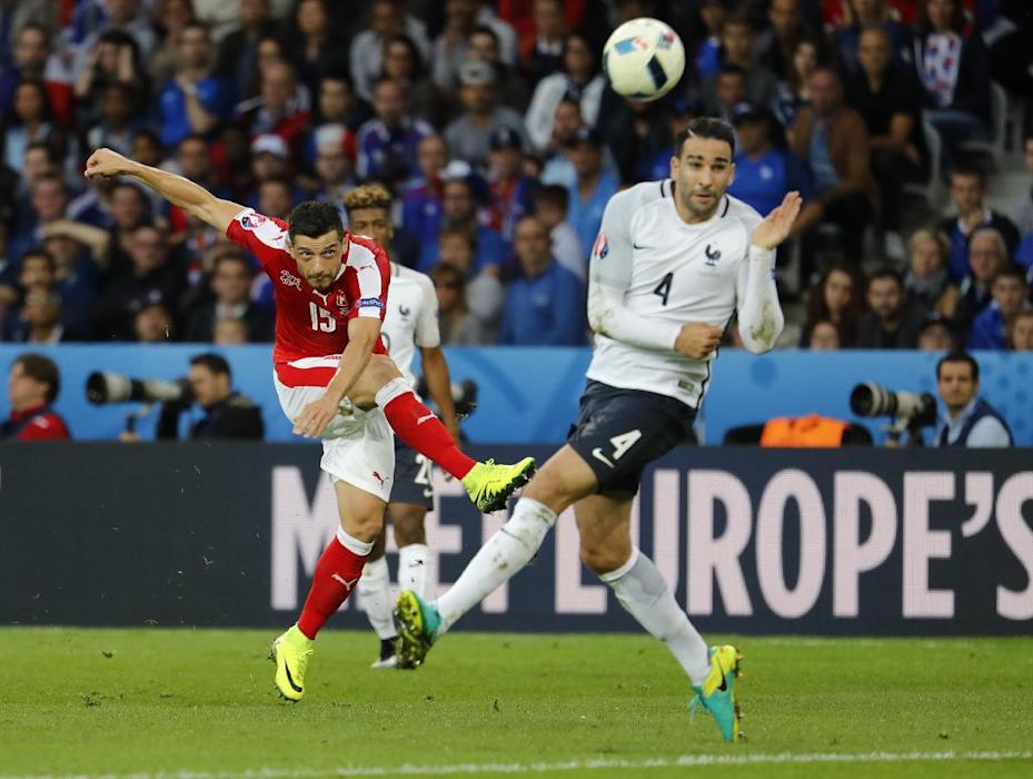 Switzerland's Blerim Dzemaili shoots at goal