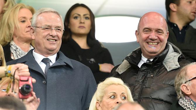File photo shows Volkswagen CEO Winterkorn and VW works council chief Osterloh at Europa League soccer match between VfL Wolfsburg and Napoli in Wolfsburg
