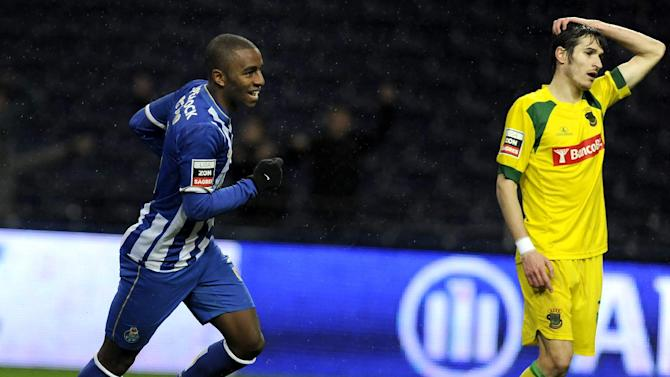 FC Porto's Ricardo Pereira celebrates after scoring his side's third goal past Pacos Ferreira's Tiago Valente, right, in a Portuguese League soccer match at the Dragao stadium in Porto, Portugal, Sunday, Feb. 9, 2014. Ricardo scored once in Porto's 3-0 victory