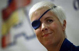 Marussia Formula One test driver Maria de Villota of Spain smiles during her news conference in Madrid October 11, 2012. REUTERS/Sergio Perez/Files