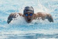 Russian swimming team skipper Yevgeny Korotyshkin clinched the national title in the men's 100-metre butterfly on the second day of the country's championships here on Wednesday. Nikolai Skvortsov, pictured in 2011, who finished second (52.08), will also compete at London