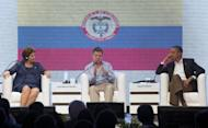President Juan Manuel Santos (C) of Colombia speaks alongside US President Barack Obama (R) and President Dilma Rousseff of Brazil during the CEO Summit on the sidelines of the Summit of the Americas in Cartagena, Colombia