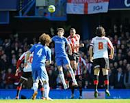 Chelsea's Oscar (centre) vies with Brentford defender Shaleum Logan during the English FA Cup fourth round replay match in London on February 17, 2013. Chelsea avoided becoming the latest victims of the FA Cup's spate of giant-killings as the holders eased into the fifth round with a 4-0 win
