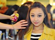 "Chinese native Qi Ji has her make-up done during a new talent show ""Asian Idol Group Competition"" in Taipei, in May. Growing numbers of young Chinese performers are eschewing the entertainment scene at home and instead coming to Taiwan in the hope of getting a big break"