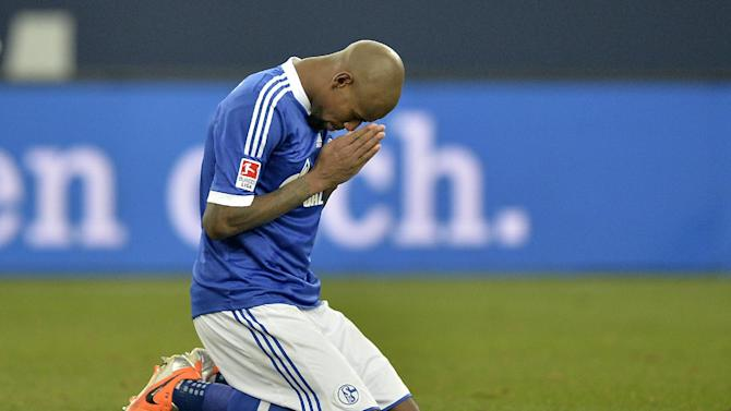 Schalke's Felipe Santana of Brazil prays on the pitch after winning the German Bundesliga soccer match between FC Schalke 04 and SV Hannover 96 in Gelsenkirchen,  Germany, Sunday, Feb. 9, 2014