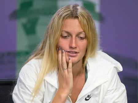 Defending champion Petra Kvitova of Czech Republic attends a news conference after losing her match against Serbia's Jelena Jankovic at the Wimbledon Tennis Championships in London