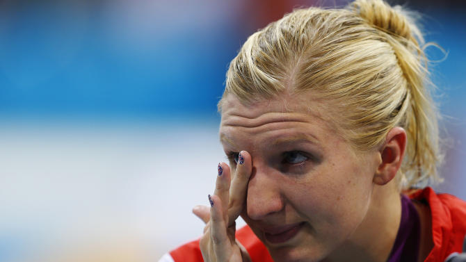 Britain's Rebecca Adlington wipes away tears after receiving her bronze medal during the women's 800m freestyle victory ceremony at the London 2012 Olympic Games at the Aquatics Centre