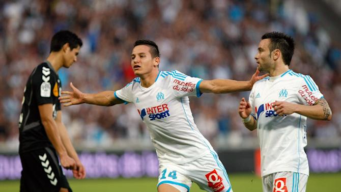 Marseille's midfielder Florian Thauvin, center, celebrates scoring against Reims during their League One soccer match at the Velodrome Stadium in Marseille, southern France, Saturday Oct. 26, 2013