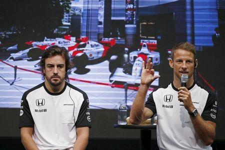 McLaren Formula One drivers Alonso of Spain and Button of Britain attend a fan meeting at the Honda Motor Co's headquarters in Tokyo