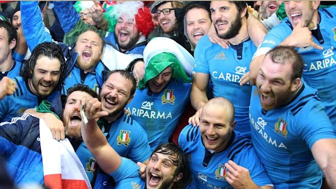 Italy's Enrico Bacchin, front centre, celebrates with fans at the end of their Six Nations rugby union international match at Murrayfield stadium, Edinburgh, Scotland, Saturday Feb. 28, 2015. (AP Photo/Lynne Cameron, PA) UNITED KINGDOM OUT
