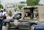A Pakistani police vehicle enters the Air Force base following a militant attack in Kamra, about 60 kilometres northwest of Islamabad, on August 16, 2012. Militants armed with guns and rocket launchers stormed the base before dawn, sparking hours of heavy clashes that killed nine people, officials said