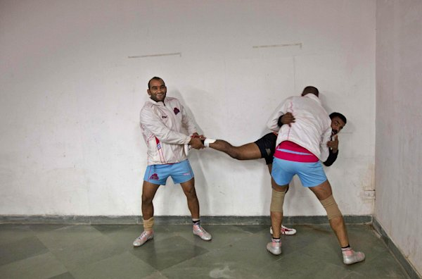 In this Aug. 31, 2014 photo, kabaddi players stretch before a game