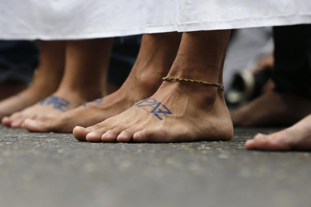 Anti-government protesters march barefooted during a protest in Caracas