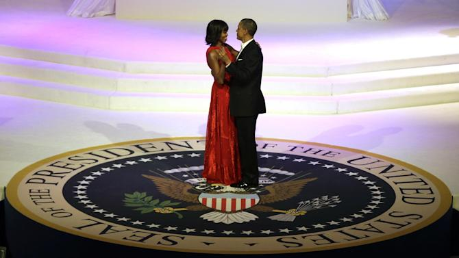 President Barack Obama and first lady Michelle Obama share a dance during the Commander-In-Chief Inaugural ball at the Washington Convention Center during the 57th Presidential Inauguration Monday, Jan. 21, 2013, in Washington.  (AP Photo/ Evan Vucci)