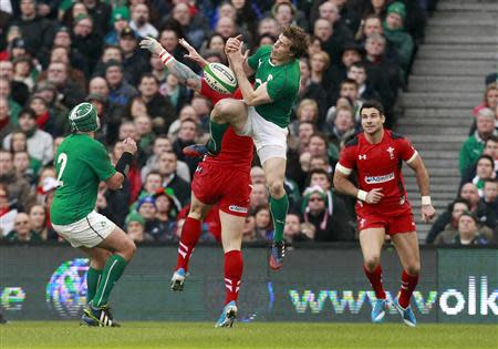 Ireland's Andrew Trimble tackles Wales' George North in their Six Nations rugby union match at Aviva stadium in Dublin