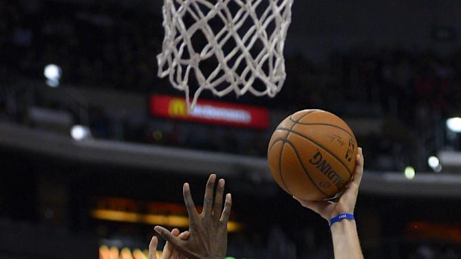 Los Angeles Clippers forward Blake Griffin, right, puts up a shot as Utah Jazz forward Marvin Williams defends during the second half of an NBA basketball game, Saturday, Feb. 1, 2014, in Los Angeles