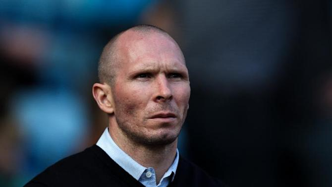 Michael Appleton gave debuts to 11 players in Portsmouth's league opener on Saturday