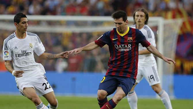 Barcelona's Lionel Messi from Argentina controls the ball past Real Madrid's Angel Di Maria from Argentina during a Spanish La Liga soccer match between Barcelona F.C. and Real Madrid at the Camp Nou stadium in Barcelona, Spain, Saturday Oct. 26, 2013