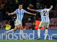 Malaga's midfielder Ignacio Camacho (L) celebrates with teammate defender Sergio Sanchez after scoring the equalizer goal during the Spanish Copa del Rey (King's Cup) quarter-final football match FC Barcelona vs Malaga CF at the Camp Nou stadium in Barcelona on January 16, 2013. The game ended in a draw 2-2