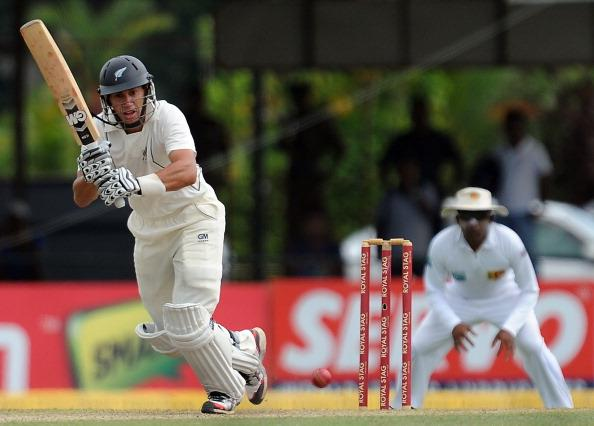 New Zealand captain Ross Taylor (L) plays a shot as Sri Lanka cricket captain Mahela Jayawardene looks on during the first day of the second and final Test match between Sri Lanka and New Zealand at t