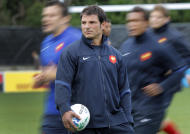 French rugby team coach Marc Lievremont supervises a training session, in Auckland, New Zealand, Tuesday, Sept. 27, 2011. France will play Tonga in their next Rugby World Cup match on Saturday, Oct. 1 in Wellington. (AP Photo/Christophe Ena)