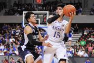 Kiefer Ravena prepares to pass the ball down low. (NPPA)