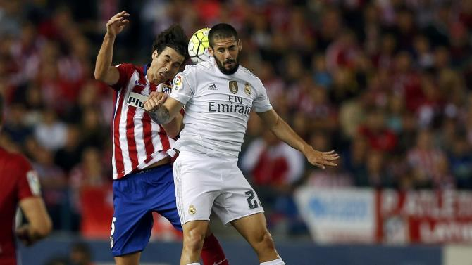 "Real Madrid's Francisco ""Isco"" Roman is challenged by  Atletico Madrid's Tiago during their Spanish first division derby soccer match in Madrid"