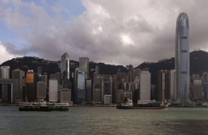 A Star Ferry sails past Hong Kong's business Central district