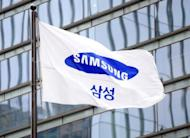 A flag bearing the Samsung logo flies outside the company's office in Seoul. South Korea's Samsung sought Monday to rally employees after a $1.05 billion US court judgment in favour of arch-rival Apple pushed its shares sharply lower amid fears about the fallout in the key American market