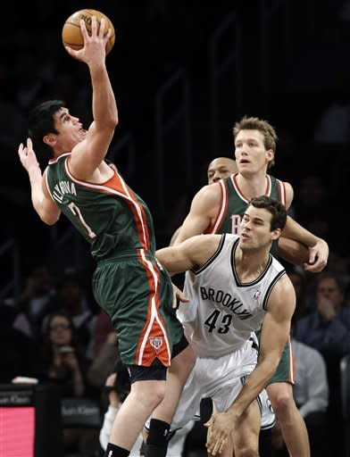 Johnson's OT buzzer-beater lifts Nets past Bucks