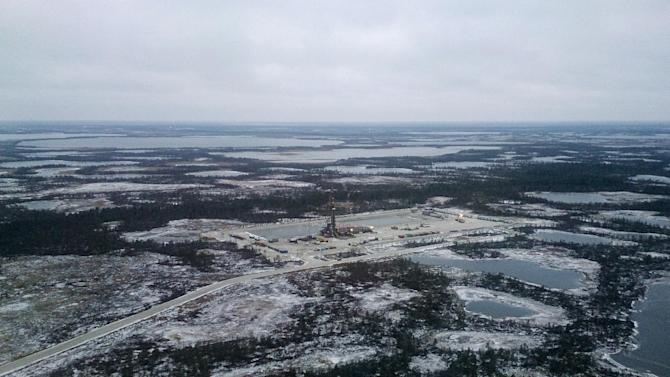 A file aerial view shows an oil derrick and other facilities of an oilfield, part of the Imilorskoye group of fields, near Kogalym