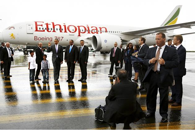 Obama, flanked by Gebremariam and Desalegn, talks to reporters after viewing a Boeing 787 Dreamliner from Ethiopian Airlines at Bole International Airport before departing Addis Ababa, Ethiopia