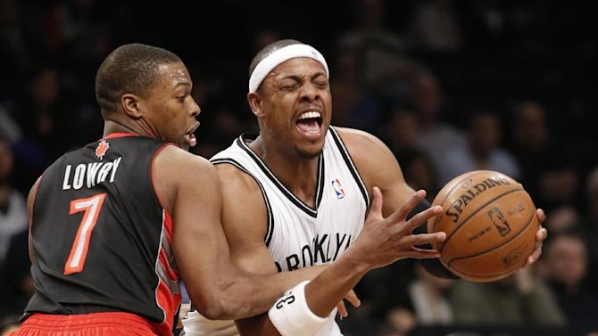 Toronto Raptors guard Kyle Lowry (7) gets tangled up with Brooklyn Nets forward Paul Pierce, right, in the first half of an NBA basketball game, Monday, Jan. 27, 2014, in New York