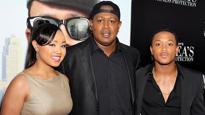 "This June 25, 2012 photo released by Starpix shows rapper-turned actor Romeo, right, his sister Cymphonique Miller, left, and their father hip hop artist Master P., at the premiere of Romeo's film, ""Tyler Perry's Madea's Witness Protection,"" in New York. Romeo says his hip-hop artist dad and filmmaker Tyler Perry have a similar work ethic and outlook on life. Perry directs and stars alongside Romeo in his latest comedy, ""Tyler Perry's Madea's Witness Protection,"" in theaters Friday.  (AP Photo/Starpix, Marion Curtis)"