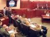 In this image taken from video, accused Colorado theater shooter James Holmes, standing on the far left, listens as the verdict is read during his trial, in Centennial, Colo., Thursday, July 16, 2015. Holmes was found guilty of murder in the deaths of 12 people in July 2012. In the center, lead prosecutor George Brauchler, looks back as the counts are read. (Colorado Judicial Department via AP, Pool)