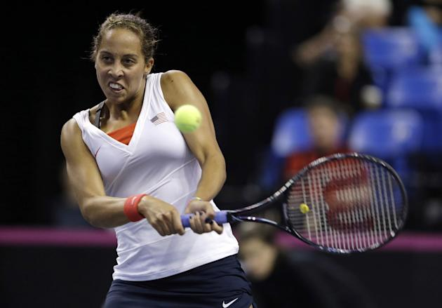 United States' Madison Keys returns the ball to France's Alize Cornet during a Fed Cup singles world group playoff tennis match Saturday, April 19, 2014, in St. Louis. Keys defeated Cornet 6-7