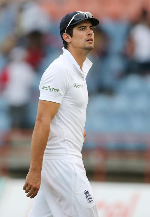 Cricket: England's Alastair Cook walks off at the end as bad light stopped play