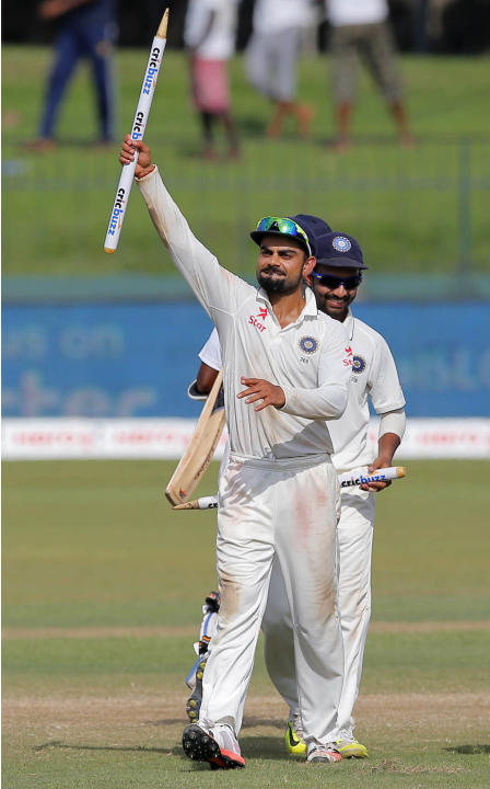 India's captain Virat Kohli holds as he as he walks off the pitch after India defeated Sri Lanka in their third test cricket match in Colombo, Sri Lanka, Tuesday, Sept. 1, 2015. India won by 117 r