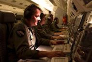 A handout photo taken on April 18, 2014 showing Australian crew searching for the missing Malaysia Airlines fight