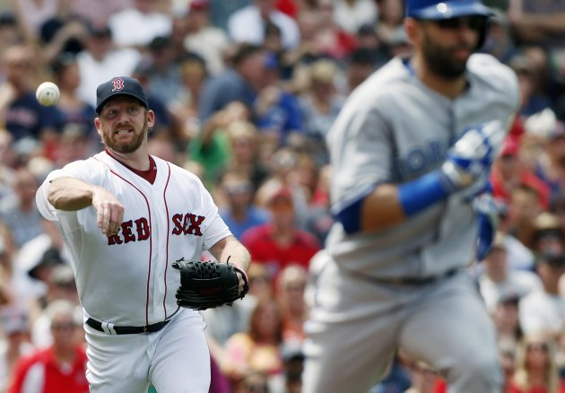 Boston Red Sox's Ryan Dempster throws out Blue Jays Jose Bautista