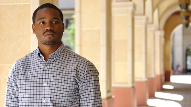 """In this Wednesday, June 19, 2013 photo, Ryan Coogler, director of the film, """"Fruitvale Station,"""" poses for a portrait at the University of Southern California in Los Angeles. Coogler's first dramatic feature, """"Fruitvale Station,"""" his first project since graduating with his master's degree in 2011, won both jury and audience awards at the Sundance Film Festival, where the Weinstein Co. outbid a dozen studios to distribute it. It opens Friday, July 12, 2013, in New York and Los Angeles and around the nation later this month, and Oscar buzz has already begun. (Photo by John Shearer/Invision/AP)"""