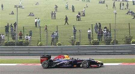 Red Bull Formula One driver Sebastian Vettel of Germany drives during the qualifying session of the Indian F1 Grand Prix at the Buddh International Circuit in Greater Noida, on the outskirts of New Delhi, October 26, 2013. REUTERS/Adnan Abidi