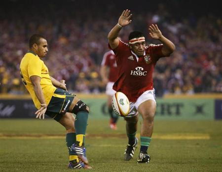 British and Irish Lions' Mako Vunipola attempts to smother a kick from Australia Wallabies' Will Genia during their rugby union test match in Melbourne