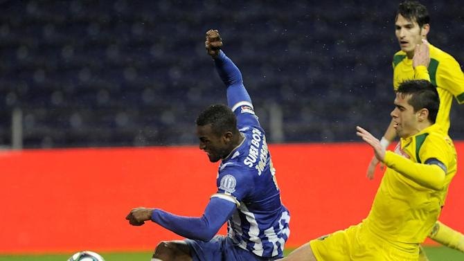 FC Porto's Jackson Martinez, from Colombia, scores his side's second goal past Pacos Ferreira's Tiago Valente, right, in a Portuguese League soccer match at the Dragao stadium in Porto, Portugal, Sunday, Feb. 9, 2014. Jackson scored once in Porto's 3-0 victory