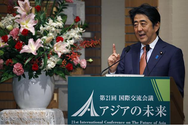"Japanese Prime Minister Shinzo Abe speaks during a banquet of a symposium on the ""Future of Asia"" in Tokyo, Thursday, May 21, 2015.  Vying to keep pace with China's rising influence and"
