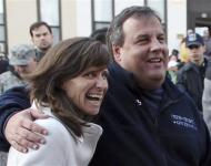New Jersey Governor Chris Christie and Hoboken Mayor Dawn Zimmer (L) speak with volunteers at a Hurricane Sandy disaster recovery headquarters in Hoboken, New Jersey, in this November 4, 2012 handout file photo. REUTERS/NJ Governor's Office/Tim Larsen/Handout via Reuters