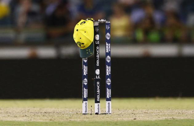 The cap of Australian bowler Josh Hazlewood sits on the stumps during a drinks break at the Cricket World Cup match between Australia and Afghanistan in Perth