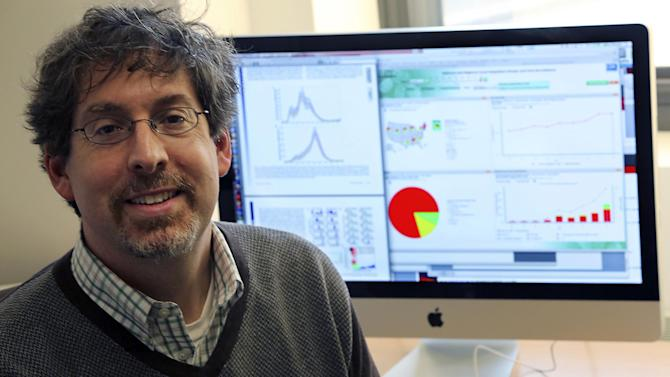 In this Thursday, Dec. 13, 2012 photo, Jeffrey Shaman poses for a portrait in his office at Columbia University's Department of Environmental Health Sciences in New York. In the study of New York City flu cases published last month in the Proceedings of the National Academy of Sciences, the authors said they could forecast, by up to seven weeks, the peak of flu season. Scientists hope to try real-time predictions as early as next year, said Jeffrey Shaman of Columbia University, who led the work.  (AP Photo/Mary Altaffer)
